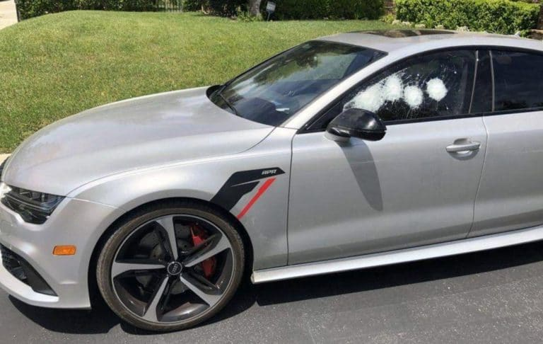 How Much Does a Bulletproof Car Cost picture of gray audi with no bullet penetrations